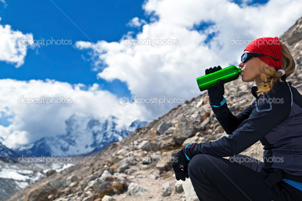 Young woman hiking on glacier in Himalaya Mountains in Nepal — Stock Photo #7375976