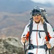 Woman trekking in mountains — Stock Photo