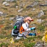 Woman trekking in mountains — Stock Photo