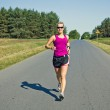 Runner on country road — Stock Photo