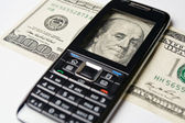 Mobile Phone and money — Stock Photo