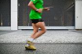 Running in city marathon — 图库照片