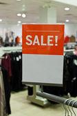 Kleidung-verkauf-zeichen — Stockfoto