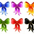 Varicoloured festive bow for a design christmas gifts - Векторная иллюстрация