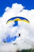 Parachuter descending in Himalaya mountains — Stock Photo