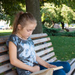 Stock Photo: Reading at park