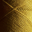 Skein of gold wool knitting yarn — Stock Photo