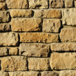Irregular masonry block wall — Stock Photo