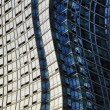 Stock Photo: Twisted glass and steel skyscraper structure