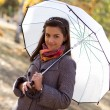 Sweet young girl with a white umbrella — Stock Photo