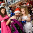 Santa Claus at a party for children - Stock Photo