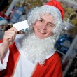 A young man dressed as Santa Claus in - Stock Photo