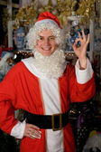 A young man dressed as Santa Claus in — Stock Photo