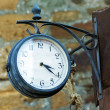 Old metal round clock — Stock Photo