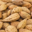 Abstract background: unshelled almonds — 图库照片