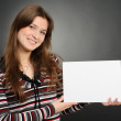 Woman holding empty white board — Stock Photo #7948672