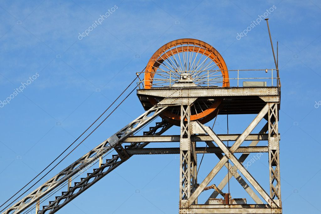 Old, disused mine shaft headgear with pulley wheel  Stock Photo #7587202