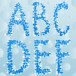 Royalty-Free Stock Vector Image: Vector winter letters on seamless background