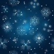 Stock Vector: Vector seamless background with snowflakes at the winter sky