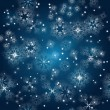 Vector seamless background with snowflakes at the winter sky — Stock Vector
