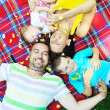 Happy young couple with their children have fun at park — Stock Photo #6768163