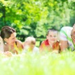 Happy young couple with their children have fun at park — Stock Photo #6769164