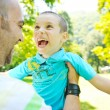 Happy father and son have fun at park — Stock Photo #6769214