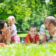 Happy young couple with their children have fun at park — Stock Photo #6769354