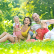 Happy young couple with their children have fun at park — Stock Photo #6771252