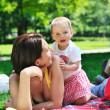Woman and baby playing at park — Stock Photo