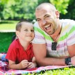 Happy father and son have fun at park — Stock Photo