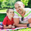 Stock Photo: Happy father and son have fun at park