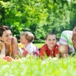Happy young couple with their children have fun at park — Stock Photo #6789568