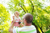 Man and baby playing in park — Stock Photo