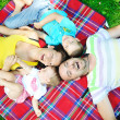 Happy young couple with their children have fun at park — Stock Photo #6810160