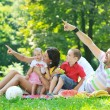 Happy young couple with their children have fun at park — Stock Photo #6835417