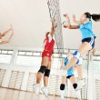 Girls playing volleyball indoor game — Stock Photo #6966809