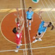 Girls playing volleyball indoor game — Stock Photo #6967916