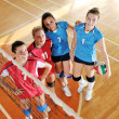 Girls playing volleyball indoor game — ストック写真