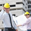 Team of architects on construciton site — Stock Photo #6974167
