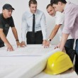 Team of architects on construciton site — Stock Photo #6976420