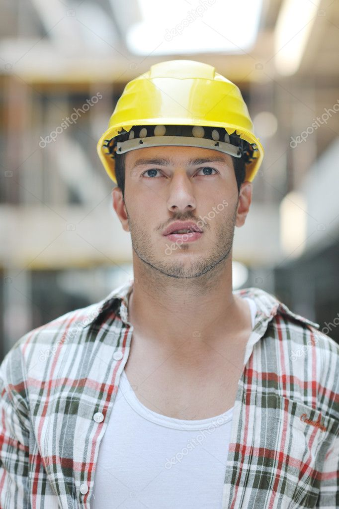 Handsome hard worker portrait at concstruction site  Stock Photo #6977710