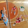 Girls playing volleyball indoor game — Stock Photo #6991146