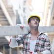 Hard worker on construction site - Stock Photo