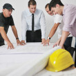 Team of architects on construciton site — Stock Photo