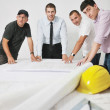Team of architects on construciton site — Stock Photo #7005672
