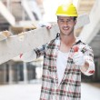 Hard worker on construction site — Stockfoto