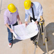 Team of architects on construciton site — Stock Photo #7020623