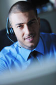 Businessman with a headset — Stock Photo