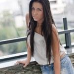 Beautiful young lady posing in garden — Stock Photo #7275978